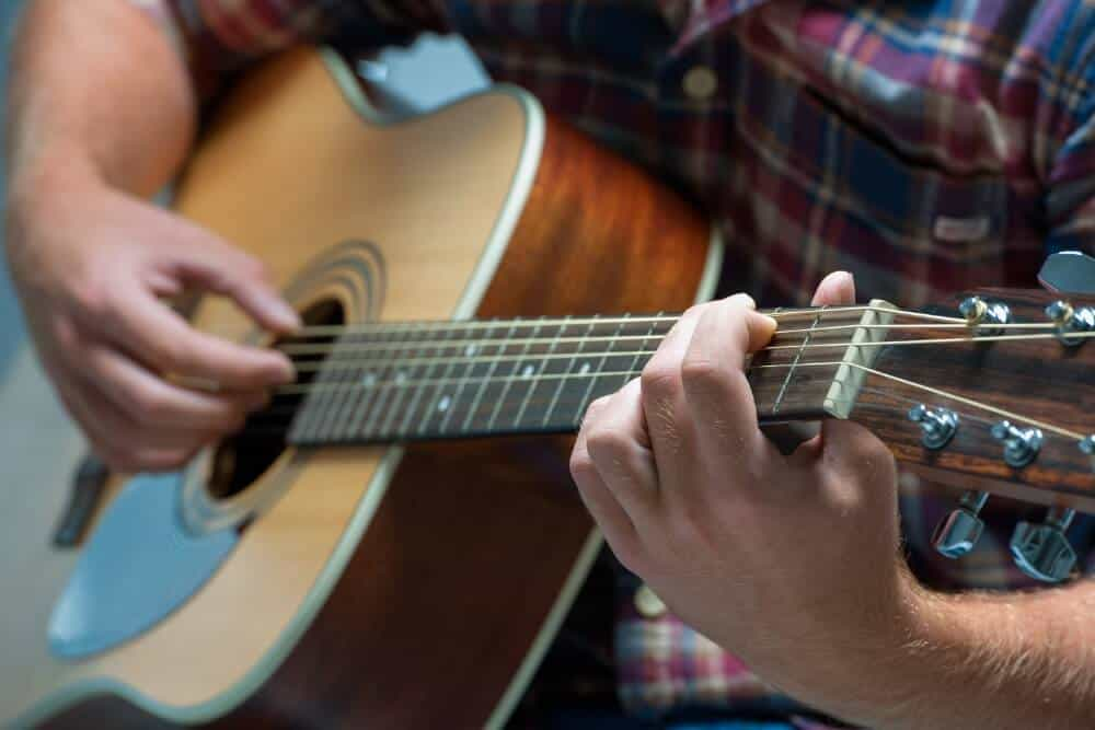 How to Lower the Action on an Acoustic Guitar